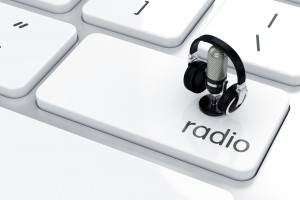 3d render of microphone with headphones icon on the keyboard. Radio concept